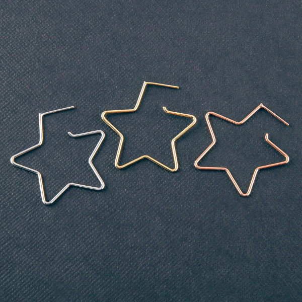 "Metal star hoop earrings featuring a stud post. Approximately 1"" in length."