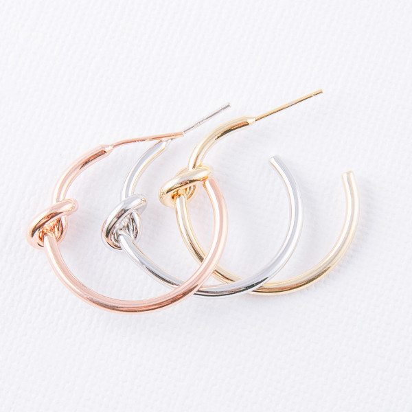 """Hoop earrings featuring a tied knot detail and stud post. Approximately 1"""" in diameter."""
