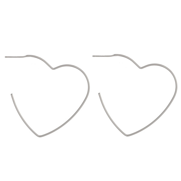 "Dainty heart hoop earrings featuring a stud post. Approximately 2"" in length."