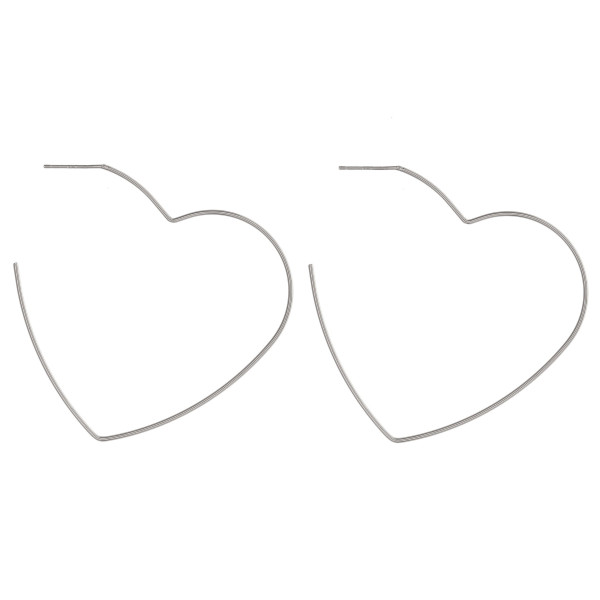 "Dainty metal heart hoop earrings featuring a stud post. Approximately 2"" in length."