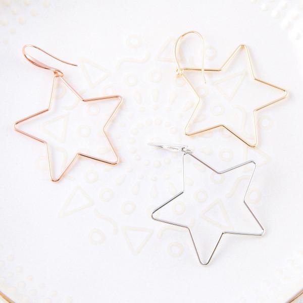 "Metal star drop earrings. Approximately 1.5"" in length."