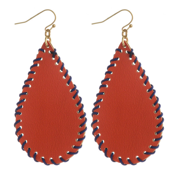 """Game Day"" faux leather teardrop earrings featuring threaded details. Approximately 2.5"" in length."