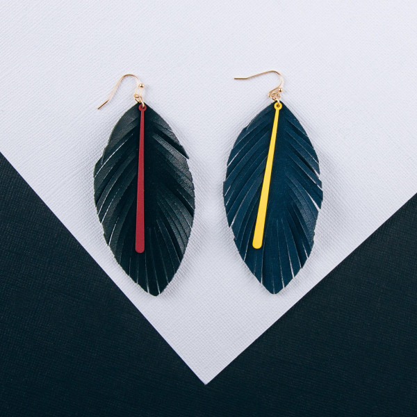 "Game day faux leather feather inspired earrings featuring a colored bar accent. Approximately 3.5"" in length."
