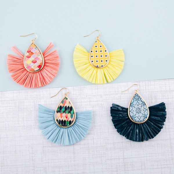 "Teardrop earrings featuring raffia tassel details with a wood inspired pattern accent. Approximately 3"" in length."