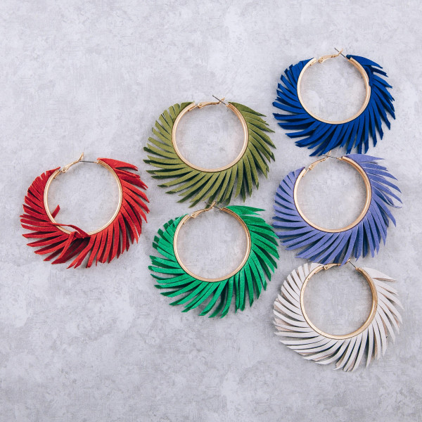"Feather inspired hoop earrings. Approximately 2"" in diameter."