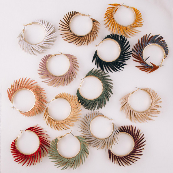 "Cork feather inspired hoop earrings. Approximately 2.5"" in diameter."