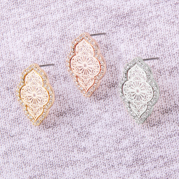"""Lotus filigree stud earrings with cubic zirconia details. Approximately .5"""" in length."""