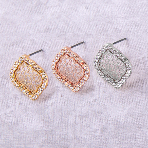 """Lotus inspired filigree stud earrings with cubic zirconia details. Approximately .5"""" in length."""