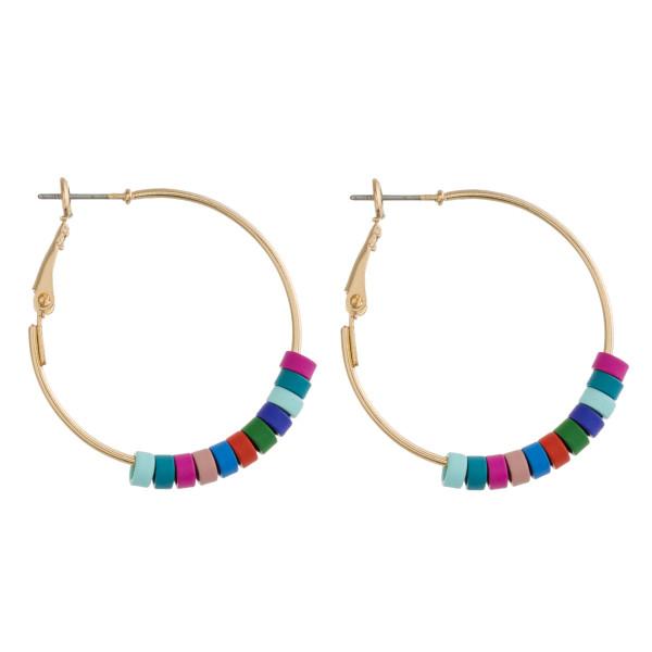 """Gold hoop color block earrings. Approximately 1.5"""" in diameter."""