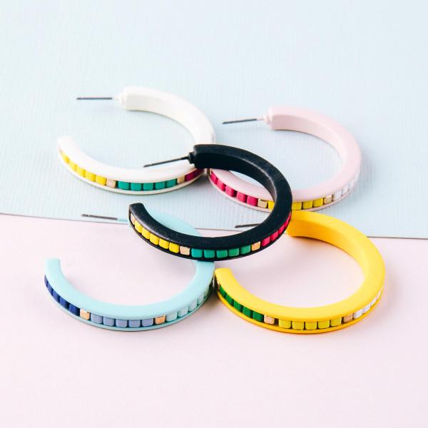 """Color block hoop earrings. Approximately 1.5"""" in diameter."""