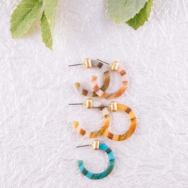 """Resin hoop earrings. Approximately 1"""" in diameter."""