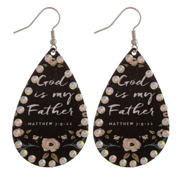"Metal plated teardrop earrings featuring ""God is my Father"" inspiring message with rhinestone details. Approximately 2"" in length."