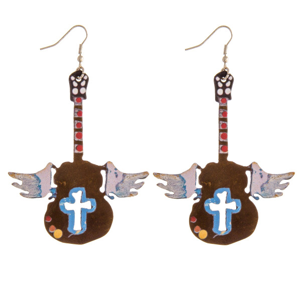 "Metal guitar earrings featuring wings and cross details. Approximately 3"" in length."