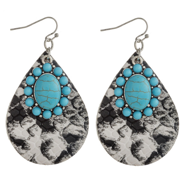 """Faux leather snakeskin teardrop earrings featuring turquoise natural stone details. Approximately 2.5"""" in length."""