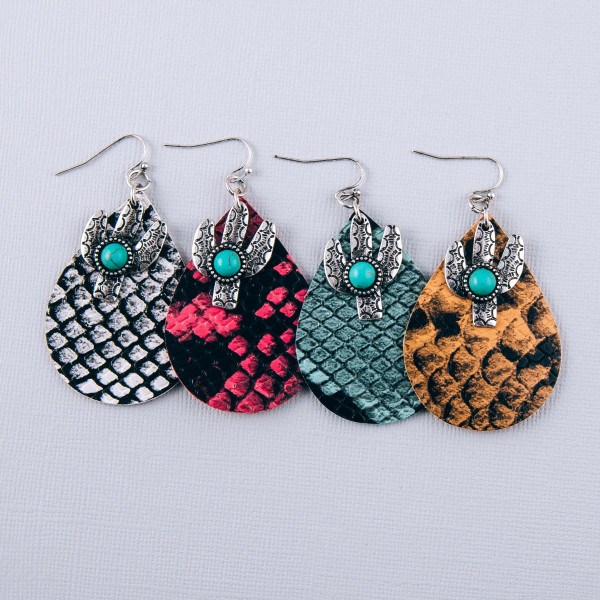 """Faux leather snakeskin teardrop earrings featuring cactus and turquoise details. Approximately 2.5"""" in length."""
