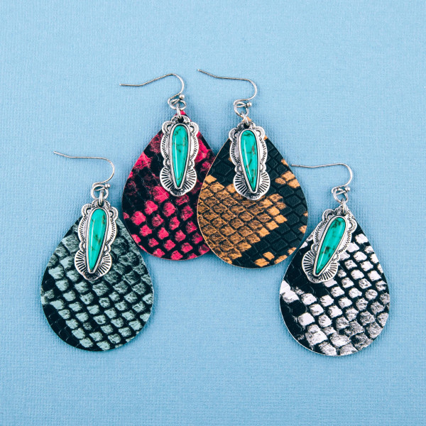 """Faux leather snakeskin teardrop earrings featuring turquoise details. Approximately 2.5"""" in length."""