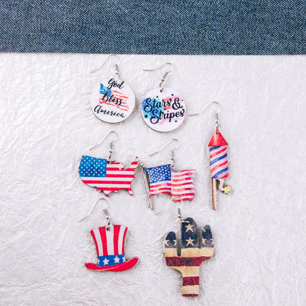 """Wood inspired disc earrings featuring """"God Bless America"""" airbrushed details. Approximately 1.5"""" in length."""