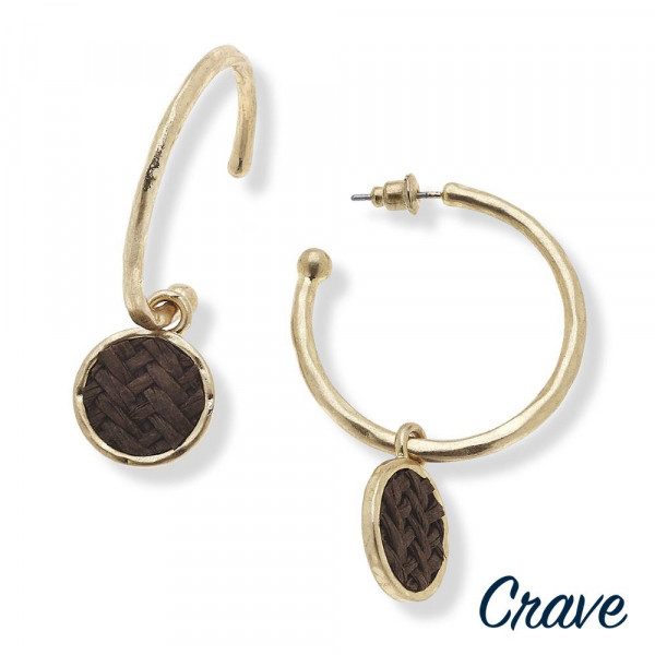 """Gold metal hoop earrings featuring a raffia woven inspired accent with a stud post. Approximately 2"""" in length."""