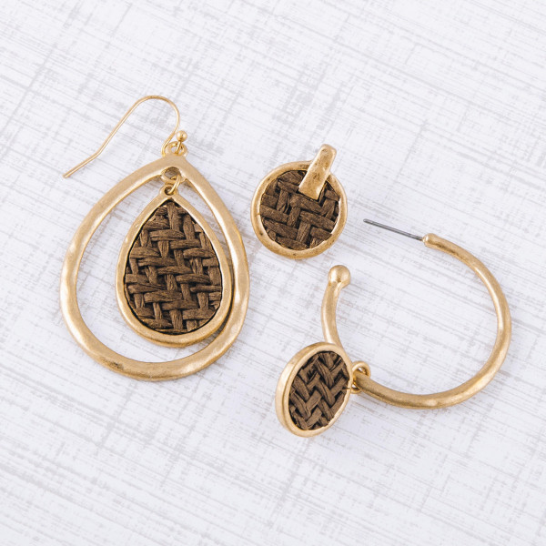 """Gold metal teardrop earrings featuring a raffia woven inspired center accent. Approximately 2"""" in length."""