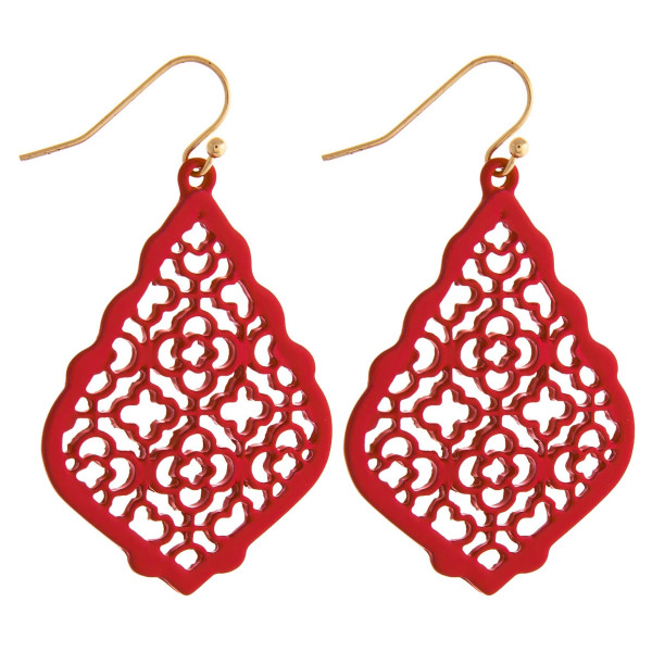 "Metal drop earrings featuring a pattern inspired detail. Approximately 2"" in length."