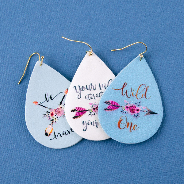 "Faux leather teardrop earrings with ""Your Vibe Attracts Tribe"" inspiring message. Approximately 2"" in length."