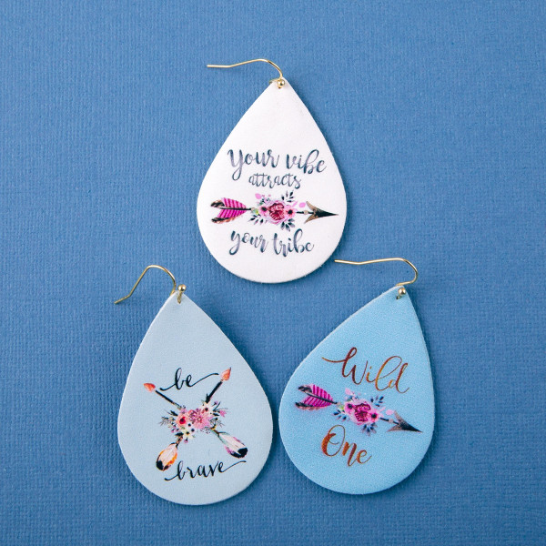 "Faux leather teardrop earrings with ""Be Brave"" inspiring message. Approximately 2"" in length."