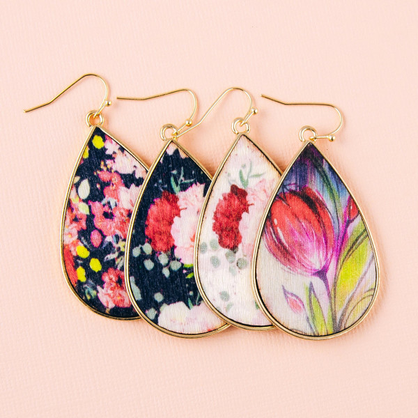 "Metal teardrop earrings featuring wood inspired floral details. Approximately 2"" in length."