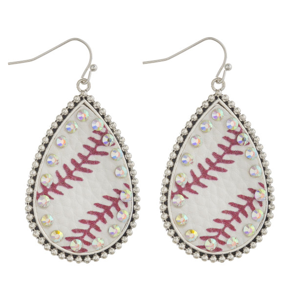 "Metal teardrop earrings featuring baseball faux leather details with rhinestone accents. Approximately 2"" in length"