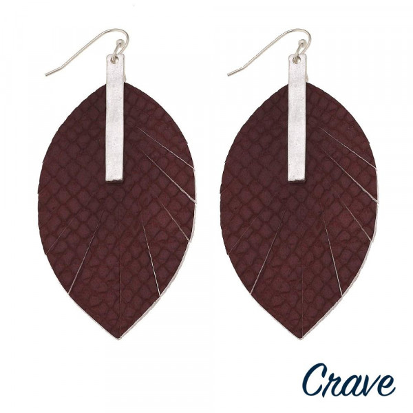 """Faux leather feather inspired earrings featuring snakeskin details and a silver bar accent. Approximately 3"""" in length."""