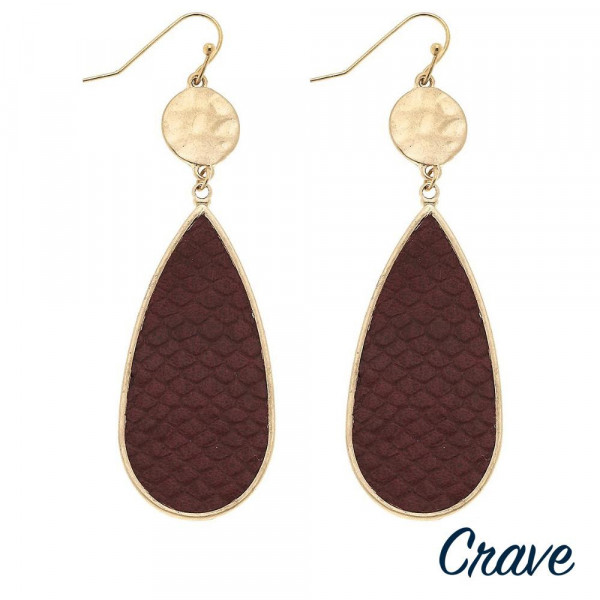 """Metal teardrop earrings featuring faux leather snakeskin details with a gold metal accent. Approximately 2.5"""" in length."""