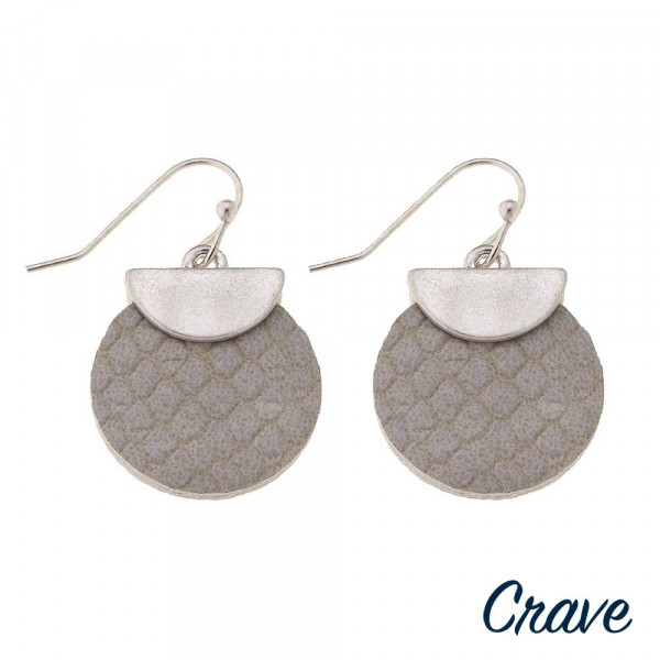 "Faux leather disc earrings featuring snakeskin details with a silver metal accent. Approximately 1"" in length."