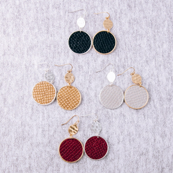 """Metal disc earrings featuring faux leather snakeskin details with a silver metal accent. Approximately 2"""" in length."""