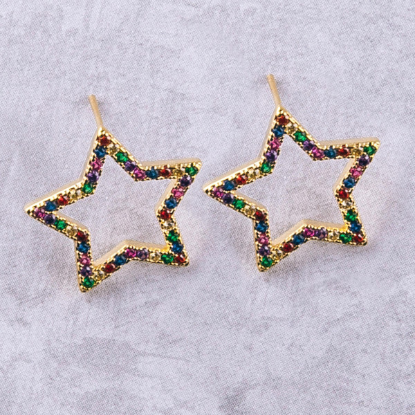 "Gold star stud earrings featuring multicolor cubic zirconia details. Approximately .5"" in diameter."