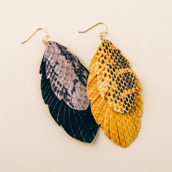 """Double layered faux leather feather inspired earrings featuring snakeskin details. Approximately 3.5"""" in length."""