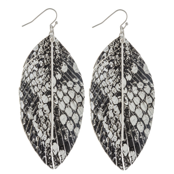 """Faux leather feather inspired earrings featuring metallic snakeskin details with a gold bar accent. Approximately 3.5"""" in length."""