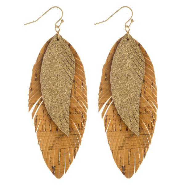 "Double layered feather inspired earrings with cork and metallic details. Approximately 3.5"" in length."