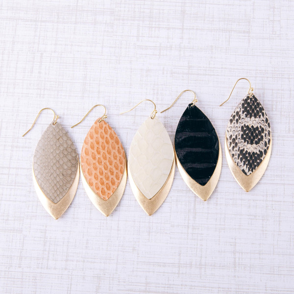 "Metal plated pointed oval earrings with faux leather snakeskin details. Approximately 2"" in length."