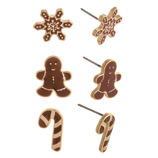 "Christmas stud earring set featuring three pairs with snowflake, gingerbread and candy cane enamel details. Approximately .5"" in size."