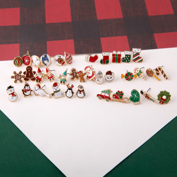 "Christmas stud earring set featuring three pairs with nutcracker, gingerbread and stocking enamel details. Approximately .5"" in size."