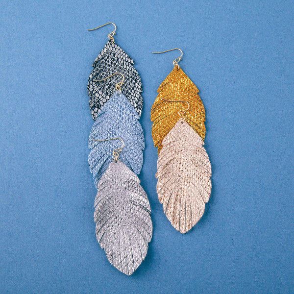 "Metallic faux leather snakeskin feather earrings. Approximately 3.5"" in length."