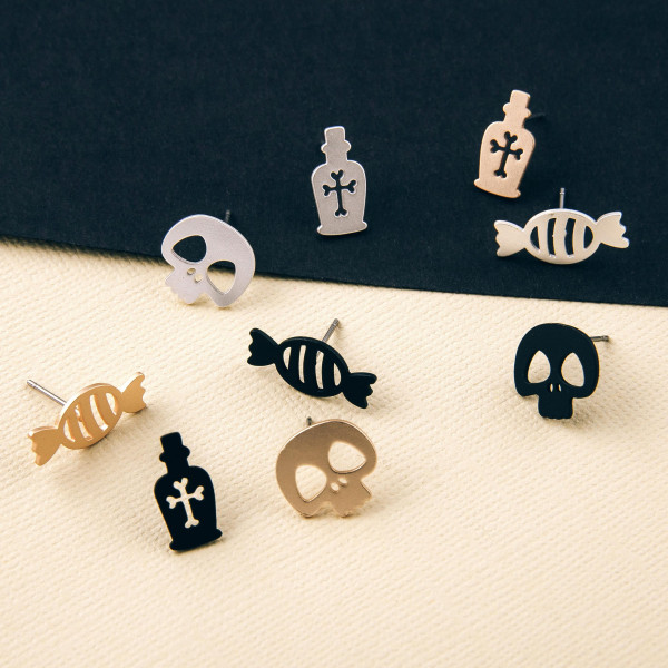 Halloween stud earring set featuring three pairs with skull, potion and candy details. Approximately 1cm in size.