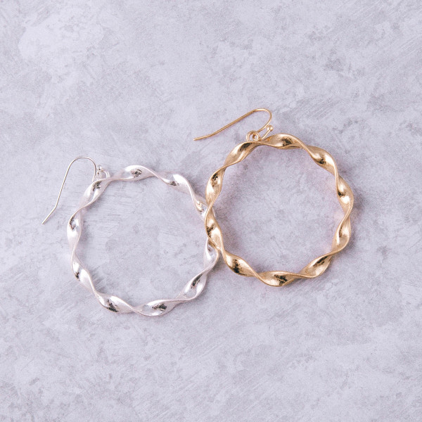 """Round twisted metal earrings. Approximately 2"""" in length."""