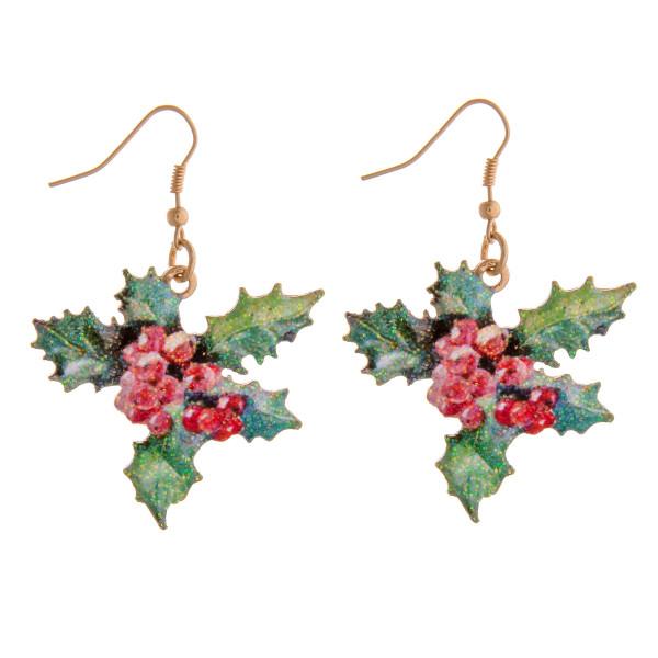 """Enamel coated mistletoe glitter dangle earrings. Approximately 2"""" in length."""