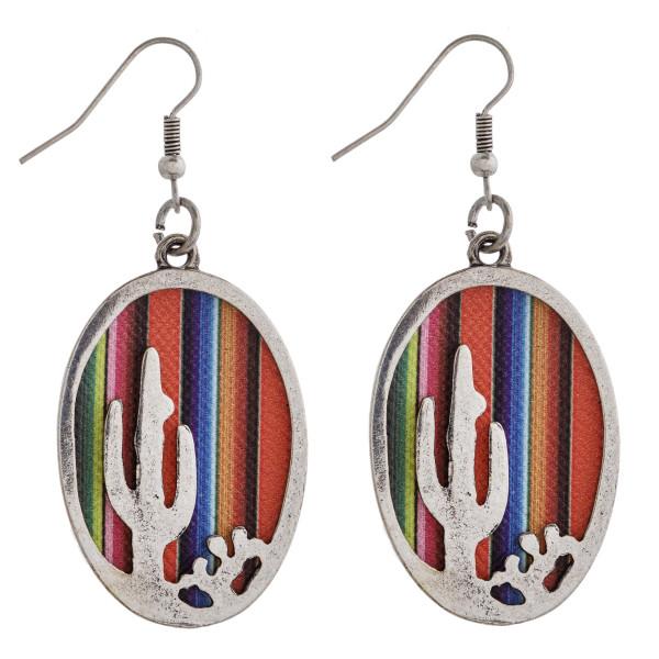 "Faux leather serape encased western cactus dangle earrings. Approximately 2"" in length."