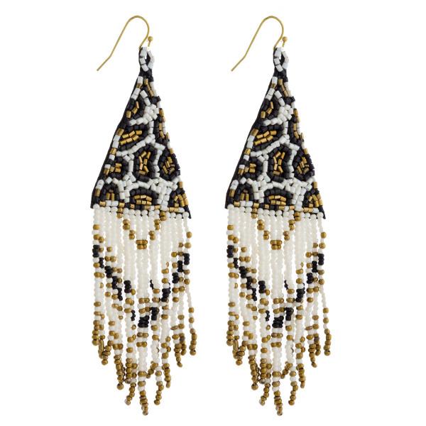 "Leopard print seed beaded triangle tassel earrings. Approximately 4.5"" in length."