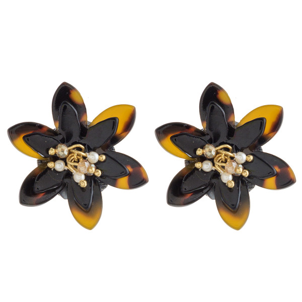 "Tortoise shell flower stud earrings with pearl beaded accents. Approximately 1"" in diameter."