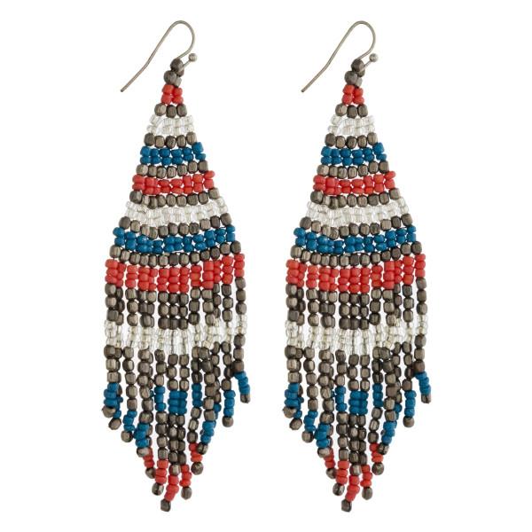"Seed beaded tassel earrings. Approximately 4"" in length."