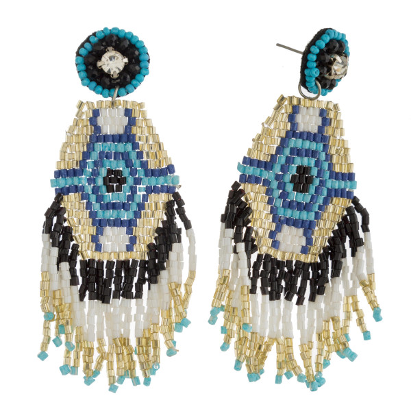 "Seed beaded tribal tassel dangle earrings with rhinestone accent. Approximately 3"" in length."