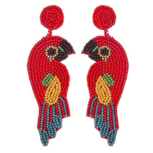 "Oversized seed beaded felt bird dangle earrings. Approximately 4"" in length."