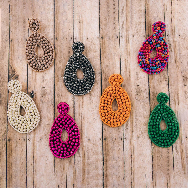 "Oversized bubble seed beaded felt teardrop earrings. Approximately 3"" in length."